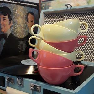 Seven retro melamine tea cups.